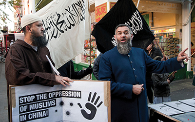 njem Choudary delivers a speech as Muslims and Islamists protest in London's China Town