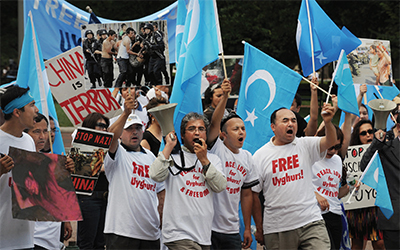 Protesters of the Islamic Uyghur ethnic group of China's Xinjing Province
