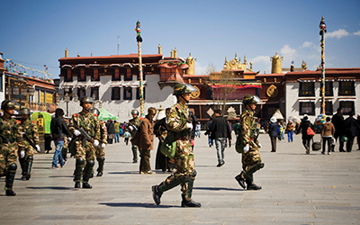 Chinese army soldiers patrol the Barkhor Square in front of Jokhang Temple