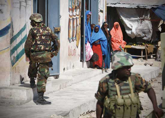 Somali women looking at AMISOM soldiers