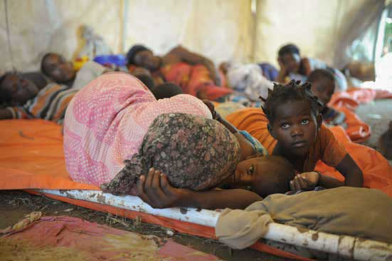 Women and children in November 2013 sleep in a makeshift hospital erected at an AMISOM military camp
