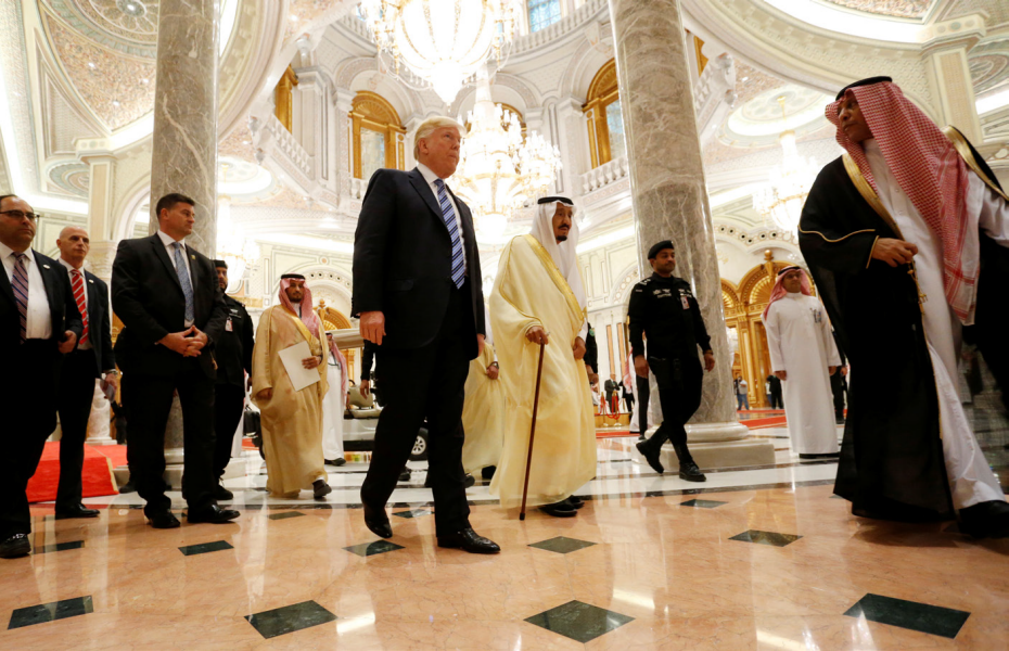 US President Donald Trump walks with Saudi Arabia's King Salman bin Abdulaziz Al Saud